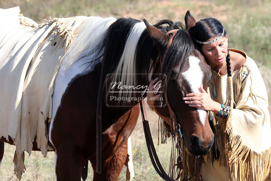 Horse whisperer A Native American Indian woman talking to her horse