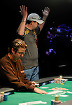 Daniel Clemente raises his arms when his flush hits on the river to double up.