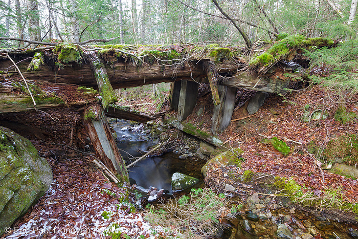 Side view of a decaying timber bridge along the abandoned Boston and Maine Railroad's Mt Washington Branch (between Fabyans and the base of the Cog) in the White Mountains, New Hampshire. The Boston, Concord & Montreal Railroad completed the roughly six and a half mile long extension from Fabyans to the base of the Cog Railway in 1876.