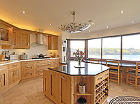 BNPS.co.uk (01202) 558833. <br /> Pic: LillicrapChilcott/BNPS<br /> <br /> Pictured: Kitchen. <br /> <br /> An impressive waterfront home with panoramic views over one of Britain's most popular estuaries is on the market for £2.75m.<br /> <br /> Tregytreath is the perfect property for boat lovers, with access to the foreshore and its own private jetty onto the water.<br /> <br /> The five-bedroom house is in Restronguet Point, one of the most exclusive waterside locations in Cornwall, and this property has one of the most outstanding positions among those prestigious homes.<br /> <br /> The house was designed and built, by the current owners 20 years ago, to make the most of the beautiful views.