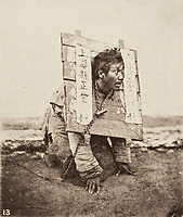 BNPS.co.uk (01202 558833)<br /> Pic: ForumAuctions/BNPS<br /> <br /> Pictured: One striking image shows a prisoner in chains with a head poking through a board covered in Chinese symbols, perhaps listing his misdemeanours.<br /> <br /> Rarely seen 150 year old photos taken by one of the first British photographers to explore China have emerged for sale for £20,000.<br /> <br /> Scotsman John Thomson (1837-1921) travelled to the Far East in 1868 and established a studio in Hong Kong, using it as a base to explore remote parts of the vast country for the next four years, photographing landmarks, scenery and the native population.<br /> <br /> In many cases, he was the first Westerner the people he photographed had encountered.<br /> <br /> One striking image shows a prisoner in chains with a head poking through a board covered in Chinese symbols, perhaps listing his misdemeanours. In another, a man poses next to a giant camel statue in the grounds around the Ming tombs of the Forbidden City.<br /> <br /> Almost 100 of his photos feature in a rare first edition of 'Thomson Illustrations of China and Its People' (1873), which is going under the hammer with London-based Forum Auctions.