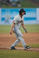Justin Foscue (20) of the Hickory Crawdads takes his lead off of third base against the Greensboro Grasshoppers at First National Bank Field on May 6, 2021 in Greensboro, North Carolina. (Brian Westerholt/Four Seam Images)
