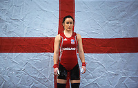 23 FEB 2014 - SMETHWICK, GBR -  Sarah Davies (ENG / GBR) of Great Britain and England, a former Miss England contestant, prepares to lift during the women's 63kg category round at the 2014 English Weightlifting Championships at the Harry Mitchell Leisure Centre in Smethwick, Great Britain. Davies'  final total of 190kg makes her eligible for selection for the England weightlifting team for the 2014 Commonwealth Games  (PHOTO COPYRIGHT © 2014 NIGEL FARROW, ALL RIGHTS RESERVED)