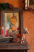 Detail of a Swedish straw Christmas decoration and candles