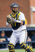 Michigan Wolverines catcher Harrison Wenson (7) prepares to throw the ball to first base against the Oakland Golden Grizzlies on May 17, 2016 at Ray Fisher Stadium in Ann Arbor, Michigan. Oakland defeated Michigan 6-5 in 10 innings. (Andrew Woolley/Four Seam Images)