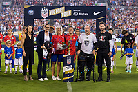 CHARLOTTE, NC - OCTOBER 3: Ali Krieger #11 of the United States celebrates her 100th cap during a game between Korea Republic and USWNT at Bank of America Stadium on October 3, 2019 in Charlotte, North Carolina.