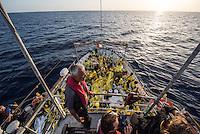 Sea Watch-2.<br /> Die Sea Watch-2 bei ihrer 13. SAR-Mission vor der libyschen Kueste.<br /> Im Bild: Crewmitglieder der Sea Watch-2 halten ausschau nach Booten mit Gefluechteten.<br /> 21.10.2016, Mediterranean Sea<br /> Copyright: Christian-Ditsch.de<br /> [Inhaltsveraendernde Manipulation des Fotos nur nach ausdruecklicher Genehmigung des Fotografen. Vereinbarungen ueber Abtretung von Persoenlichkeitsrechten/Model Release der abgebildeten Person/Personen liegen nicht vor. NO MODEL RELEASE! Nur fuer Redaktionelle Zwecke. Don't publish without copyright Christian-Ditsch.de, Veroeffentlichung nur mit Fotografennennung, sowie gegen Honorar, MwSt. und Beleg. Konto: I N G - D i B a, IBAN DE58500105175400192269, BIC INGDDEFFXXX, Kontakt: post@christian-ditsch.de<br /> Bei der Bearbeitung der Dateiinformationen darf die Urheberkennzeichnung in den EXIF- und  IPTC-Daten nicht entfernt werden, diese sind in digitalen Medien nach §95c UrhG rechtlich geschuetzt. Der Urhebervermerk wird gemaess §13 UrhG verlangt.]