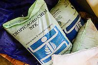 BURKINA FASO, Dano, Farmer Kooperative COPSA-C, NPK UREA fertilizer store / Duenger Lager
