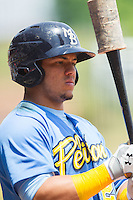 Jorge Alfaro (24) of the Myrtle Beach Pelicans checks his bat before stepping up to the plate against the Winston-Salem Dash at BB&T Ballpark on May 7, 2014 in Winston-Salem, North Carolina.  The Pelicans defeated the Dash 5-4 in 11 innings.  (Brian Westerholt/Four Seam Images)