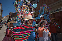 "Group of women carry their Tata Kajchu (Saint of the mine) to the Cathedral to be blessed, in this case a statue of the Virgin Mary. Potosi, Bolivia. 23 January 2016. With this blessing, they begin the festivities of the Miners Carnival./ Grupo de mujeres llevan a su Tata Kajchu (santo de la mina) a la catedral para su correspondiente bendición, en este caso una estatua de la Virgen María. Potosí, Bolivia. Enero 23 de 2016. Con esta bendicion empiezan las fiestas del Carnaval Minero. The customs and beliefs of Andean people are a hybrid of catholic religion and old beliefs. One of its highest expressions is within the Bolivian mining culture that worships the Pacha Mama (Mother Earth), the Celestial Divinity personified in the Catholic God and ""El Tio"" of the mine (Satan). To the latter, who rules the underworld, they make offerings with sacrifices of llamas inside the mines to ask for protection in the depths of the mountain and abundant mineral."