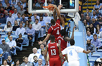 CHAPEL HILL, NC - FEBRUARY 25: Armando Bacot #5 of the University of North Carolina dunks the ball while being fouled by Jericole Hellems #4 of North Carolina State University during a game between NC State and North Carolina at Dean E. Smith Center on February 25, 2020 in Chapel Hill, North Carolina.