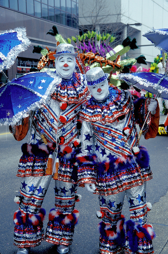 clown, humor, costume, parade, Philadelphia, PA, Pennsylvania, Two men dressed as clowns in funny red, white and blue outfits with umbrellas pose for a picture in the Mummers Day Parade on New Years Day in Philadelphia.