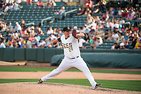 Jeremy McBryde (24) of the Salt Lake Bees delivers a pitch to the plate against the Albuquerque Isotopes in Pacific Coast League action at Smith's Ballpark on June 8, 2015 in Salt Lake City, Utah.  (Stephen Smith/Four Seam Images)