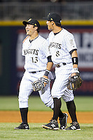 Tyler Saladino (right) puts his arm around teammate Carlos Sanchez (left) after their win over the Durham Bulls at BB&T Ballpark on April 24, 2014 in Charlotte, North Carolina.  The Knights defeated the Bulls 4-3.  (Brian Westerholt/Four Seam Images)