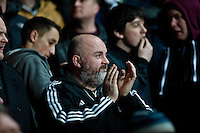 Swansea, UK. Thursday 20 February 2014<br /> Pictured: Swansea fan applauds the team as they leave the field <br /> Re: UEFA Europa League, Swansea City FC v SSC Napoli at the Liberty Stadium, south Wales, UK