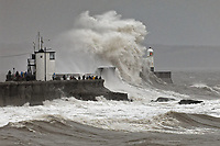 Pictured: Waves crash against the promenade wall and lighthouse in Porthcawl, south Wales, UK. Saturday 15 February 2020<br /> Re: Strong winds and heavy rain caused by storm Dennis has been affecting parts of the UK.