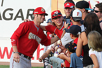 Harrisburg Senators outfielder Bryce Harper #34 poses for photos with fans before a game against the Erie SeaWolves at Jerry Uht Park on August 6, 2011 in Erie, Pennsylvania.  Harrisburg defeated Erie 10-6.  (Mike Janes/Four Seam Images)