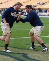 Notre Dame linemen Taylor Dever (left) and Zack Martin warm up. The Notre Dame Fighting Irish defeated the Pitt Panthers 15-12 at Heinz field in Pittsburgh, Pennsylvania on September 24, 2011.