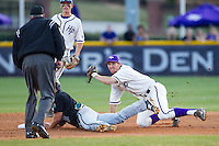 High Point Panthers shortstop Tony Fortier-Bensen (8) looks to umpire Reid Churchill for the call after applying the tag to Richard Carter (10) of the Coastal Carolina Chanticleers at Willard Stadium on March 15, 2014 in High Point, North Carolina.  The Panthers defeated the Chanticleers 11-8 in game two of a double-header.  (Brian Westerholt/Four Seam Images)