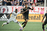 FOXBOROUGH, MA - AUGUST 3: Luis Caicedo #27 of New England Revolution battles Mark-Anthony Kaye #14 of Los Angeles FC for the ball during a game between Los Angeles FC and New England Revolution at Gillette Stadium on August 3, 2019 in Foxborough, Massachusetts.