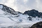 Austria, Tyrol, Kaunertal Valley: ski runs at the end of Kaunertal Glacier Road at Weissseeferner Glacier, due to climate warming parts of the glacier are covered with canvas | Oesterreich, Tirol, Kaunertal in den Ötztaler Alpen: Am Ende der Kaunertaler Gletscherstrasse, Skigebiet am  Weissseeferner, aufgrund der Klimaerwaermung werden Teile des Gletschers im Sommer mit Planen abgedeckt