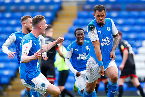 1st May 2021; Weston Homes Stadium, Peterborough, Cambridgeshire, England; English Football League One Football, Peterborough United versus Lincoln City; Jonson Clarke-Harris of Peterborough United removes his shirt to celebrate his penalty goal after 95 minutes to level the game at 3-3 and guarantee Peterborough United automatic promotion to the EFL Championship