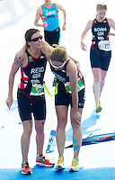 31 MAY 2014 - LONDON, GBR - Melissa Reid (GBR) (left) of Great Britain and her guide recover after winning the 2014 ITU World Triathlon Series PT5 Paratriathlon in Hyde Park, London, Great Britain (PHOTO COPYRIGHT © 2014 NIGEL FARROW, ALL RIGHTS RESERVED)