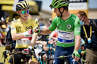 yellow jersey / GC leader Tadej Pogacar (SVN/UAE-Emirates) & Green Jersey / points leader Mark Cavendish (GBR/Deceuninck - Quick Step) greeting each other at the stage start in Carcassonne<br /> <br /> Stage 14 from Carcassonne to Quillan (184km)<br /> 108th Tour de France 2021 (2.UWT)<br /> <br /> ©kramon