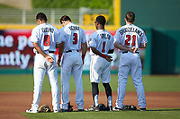 (L-R) Lansing Lugnuts infielders Yeltsin Gudino (8), Kevin Vicuna (3), Samad Taylor (1), and Brandon Grudzielanek (21) stand for the National Anthem prior to the game against the South Bend Cubs at Cooley Law School Stadium on June 15, 2018 in Lansing, Michigan. The Lugnuts defeated the Cubs 6-4.  (Brian Westerholt/Four Seam Images)