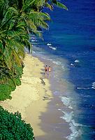 Couple walking along Diamond Head beach