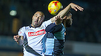 Thierry Audel of Notts County & Aaron Amadi-Holloway of Wycombe Wanderers go up for the ball during the Sky Bet League 2 match between Wycombe Wanderers and Notts County at Adams Park, High Wycombe, England on 15 December 2015. Photo by Andy Rowland.