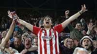 A Brentford fan celebrates at the final whistle after his team earn a draw against Liverpool during Brentford vs Liverpool, Premier League Football at the Brentford Community Stadium on 25th September 2021