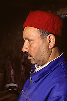 Man Wearing a Traditional Tunisian Hat, a Chechia.  MORE IMAGES AVAILABLE SHOWING STEPS IN MANUFACTURING PROCESS.