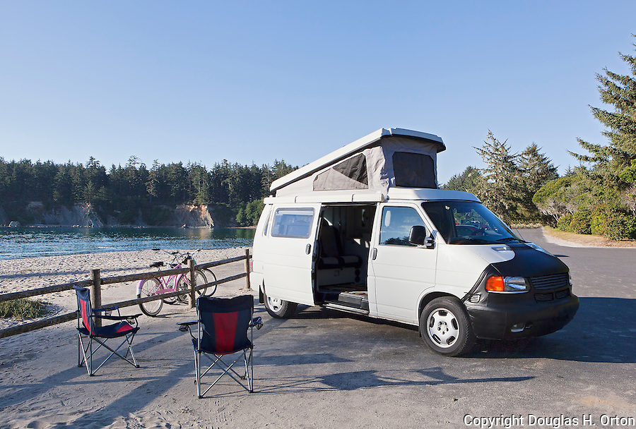 Volkswagon Camper, Sandy beaches of Sunset Bay State Park, which offers camping, fishing, hiking and day use facilities.  Cape Arago on the Central Oregon Coast with views of Sunset State Park and the Umpqua River Lighthouse, and massive headlands. Near Coos Bay, Oregon, Cape Arago is known for its rugged views, hiking, wildlife, beach access, and Sunset Beach State Park and unique geology. Available exclusively through www.spacesimages.com