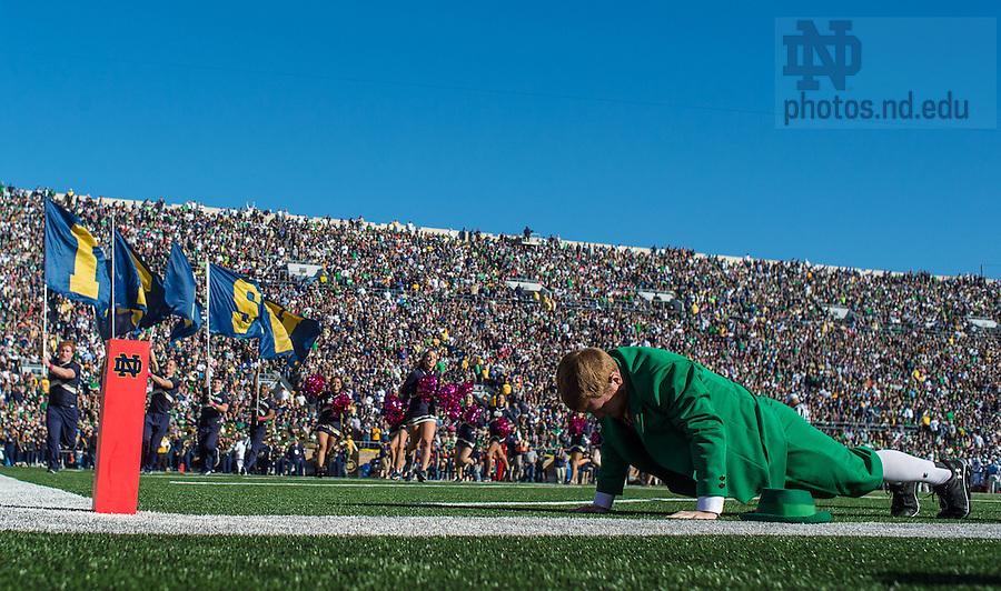 Oct 11, 2014; The Leprechaun does pushups after an Irish TD. (Photo by Matt Cashore)