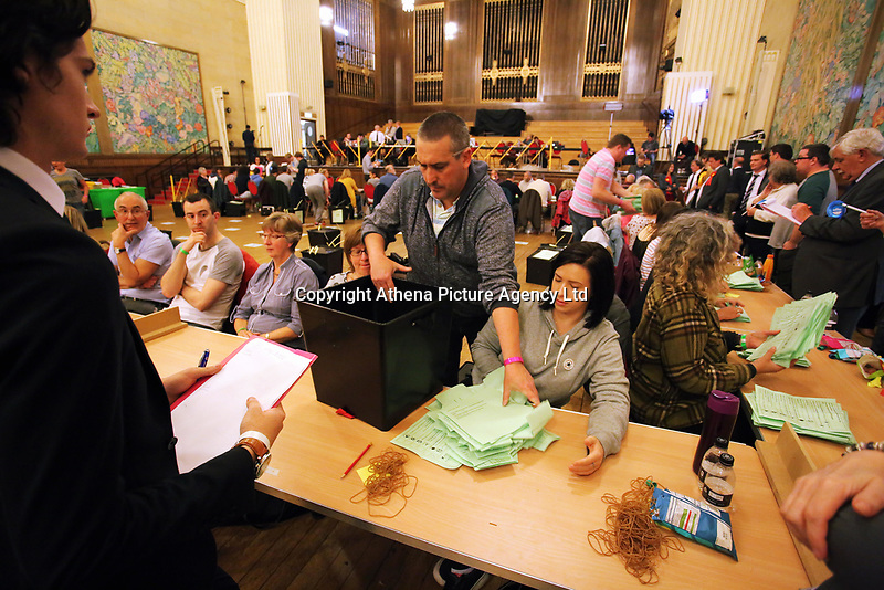 Pictured: A Council employee empties a ballot box.  Friday 09 June 2017<br />Re: Counting of ballots at Brangwyn Hall for the general election in Swansea, Wales, UK