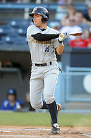 Charleston RiverDogs third baseman Dante Bichette Jr. #19 swings at a pitch during a game against the Asheville Tourists at McCormick Field on May 28, 2012 in Asheville, North Carolina . The Tourists defeated the RiverDogs 15-12. (Tony Farlow/Four Seam Images).