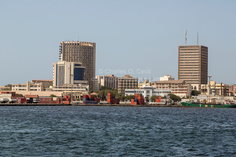 Dakar, Senegal.  Dakar Port.  Shipping containers await ships on the docks.  The tall building on the left is the BCEAO Headquarters, Banque Centrale des Etats de l'Afrique de l'Ouest, Central Bank of West African States.  This is the bank that administers the common currency used by eight West African nations, the French West African franc (franc CFA).  Dakar is the headquarters of the bank.