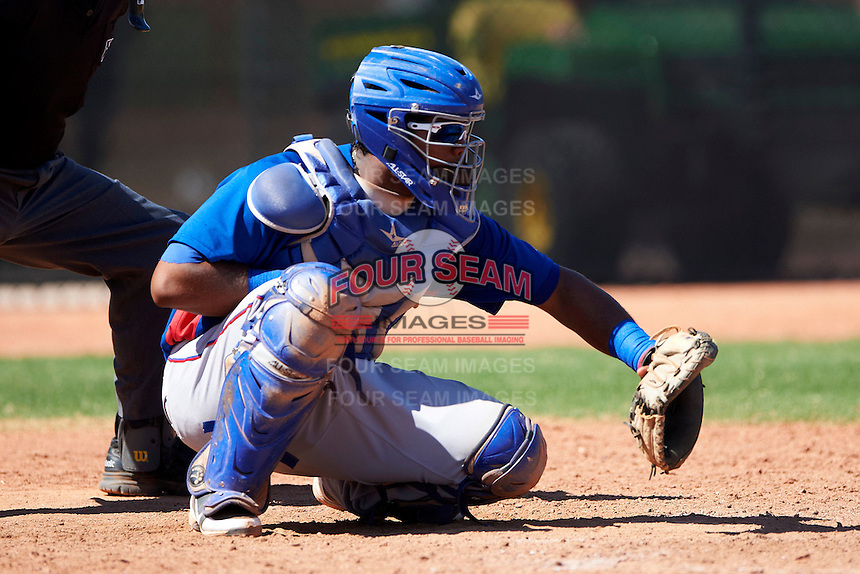 Texas Rangers minor league catcher / first baseman Fernando Vivili #22 during an instructional league game against the Kansas City Royals at the Surprise Stadium Minor League Complex on October 10, 2012 in Surprise, Arizona.  (Mike Janes/Four Seam Images)
