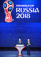 25.07.2015. St Petersburg, Russia.  Russian President Vladimir Putin (L) and FIFA President Joseph S. Blatter stand on stage during the Preliminary Draw of the FIFA World Cup 2018 in St. Petersburg, Russia, 25 July 2015. St. Petersburg is one of the host cities of the FIFA World Cup 2018 in Russia which will take place from 14 June until 15 July 2018.