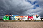 Great Britain, England, Suffolk, Thorpeness: Colourful beach side houses