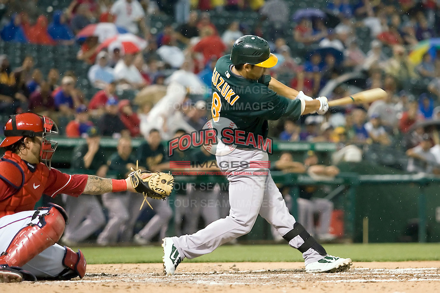 Oakland Athletics catcher Kurt Suzuki (8) swings against the Texas Rangers in American League baseball on May 11, 2011 at the Rangers Ballpark in Arlington, Texas. (Photo by Andrew Woolley / Four Seam Images)