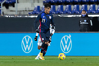 WIENER NEUSTADT, AUSTRIA - : Ulysses Llanez Jr #21 of the United States moves looking for an open man during a game between  at Stadion Wiener Neustadt on ,  in Wiener Neustadt, Austria.