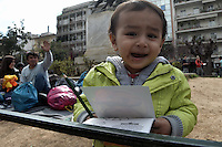 Pictured: A young migrant boy  Friday 26 February 2016<br /> Re: Hundreds of refugees have temporarily camped at Victoria Square in central Athens, Greece.