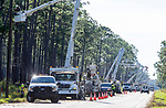 CARRABELLE, FL - OCTOBER 12: Power crews work to restore power on US 98 after Hurricane Michael on October 12, 2018 outside Carrabelle, Florida. (Photo by Mark Wallheiser/Getty Images)