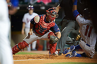 Pawtucket Red Sox catcher Dan Butler (12) looks to tag Christian Lopes (11) sliding home safely during a game against the Buffalo Bisons on August 31, 2017 at Coca-Cola Field in Buffalo, New York.  Buffalo defeated Pawtucket 4-2.  (Mike Janes/Four Seam Images)
