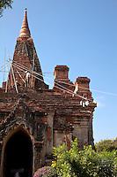Myanmar, Burma.  Manuha Temple, Bagan, 11th. Century.  Repair Work in Progress, Using Rope and Pulley System to Raise Buckets.