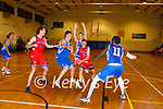 Mark O'Shea Cougars drives past Conor Ryan and Tale Fam Thiam Blue Demons during their National league game in Killarney on Saturday night