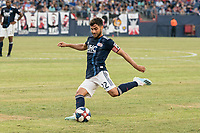 FOXBOROUGH, MA - JULY 27:  Carles Gil #22 crosses the ball towards the goal at Gillette Stadium on July 27, 2019 in Foxborough, Massachusetts.
