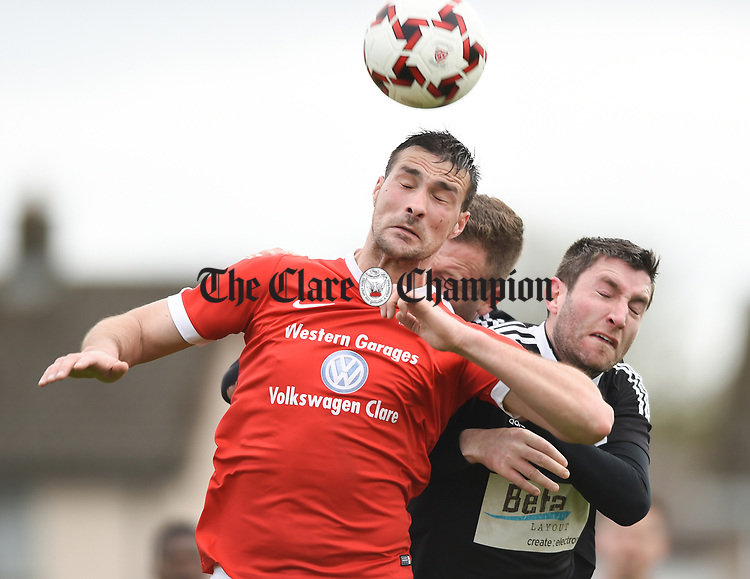 Stephen Kelly of Newmarket Celtic in action against Aidan Hurley of Janesboro during their Munster Junior Cup semi-final at Limerick. Photograph by John Kelly.